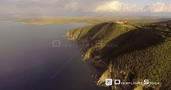 Aerial, beautiful landscape view on the sea  and on the coast in Tuscany, Italy on sunset