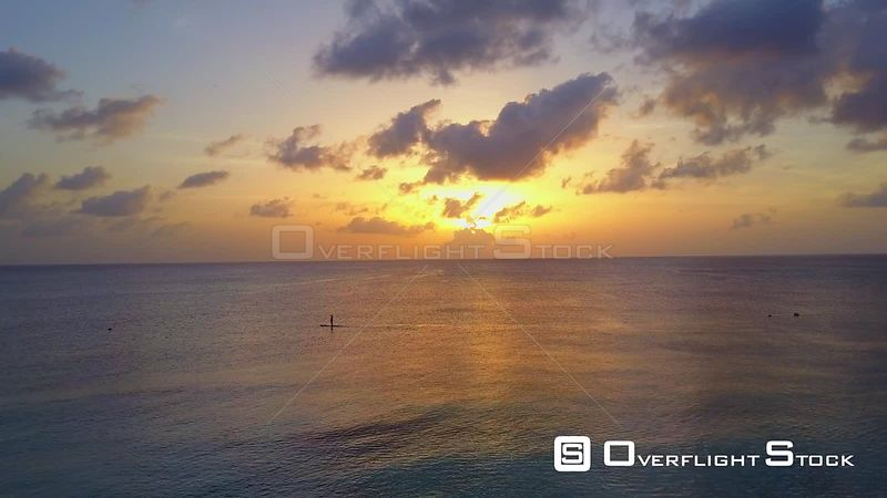 Paddle Boarder on Caribbean Ocean at Sunset Cayman Islands
