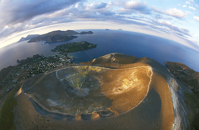 Aerial view into the caldera of Vulcano, a small volcanic island in the Aeolian archipelago. From here we can see Lipari on t...