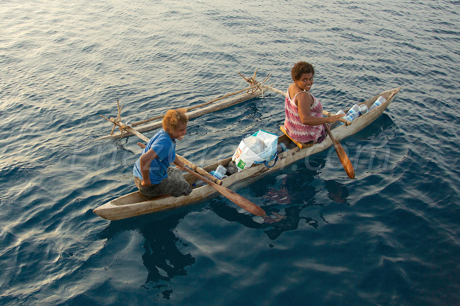 Vanua Lava natives on Wooden canoes