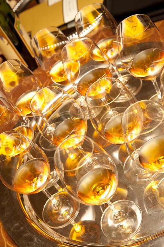 Elevated view of golden wine glasses on tray