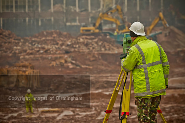 Surveyor on a demolition site, Birmingham, Enlgland