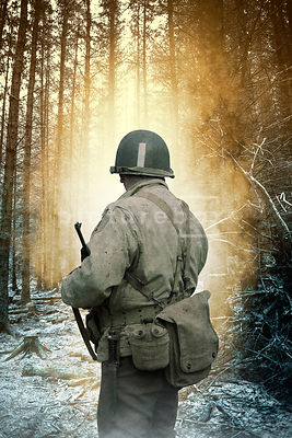 A second world war American soldier in a forest at dawn. WW2.