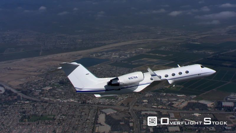 Air-to-air view of executive jet from close-up to zoom-out