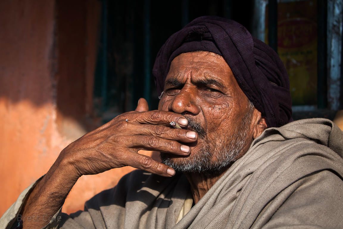 A man smokes a cigarette in Sarnath, near Varanasi, India. Sarnath is an important historical site to Buddhists.