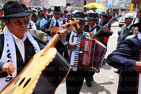 Musicians playing acoustic bass guitar and accordion, Virgen de la Candelaria festival, Puno, Peru