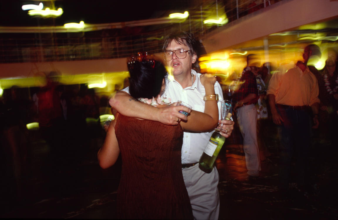 Passengers dance at a late night party on board the P&O Cruise Liner Oriana