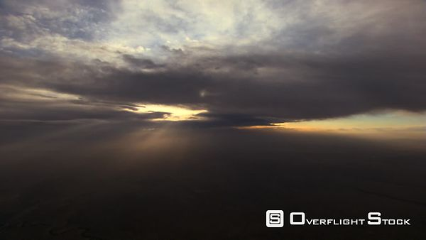 Flying toward sunrays between cloud layers