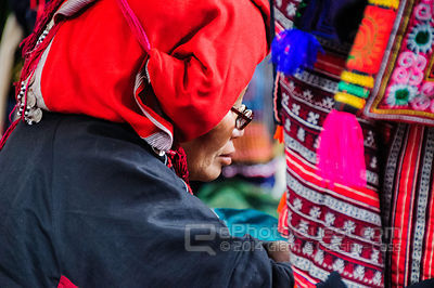 Red Zao Woman Sewing
