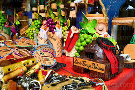 Miniature ceramic oven, leather wine bottle holders and purses and other items for sale in souvenir shop, Tarija, Bolivia
