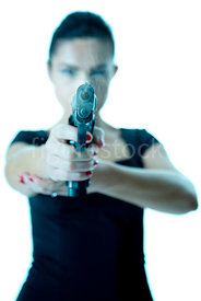 A woman standing pointing a smoking gun – shot from mid level.