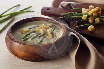 Asparagus soup cream with croutons on white background