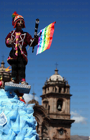 Part of statue of San Cristobal and Compañia de Jesus church tower, Corpus Christi festival , Cusco , Peru