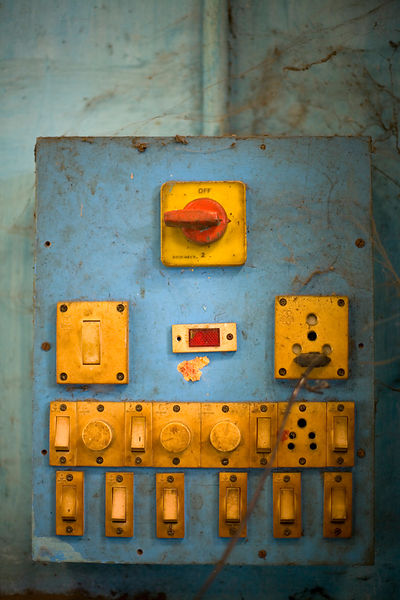India - Swamimalai - A control panel of switches for lighting at the workshops of the Stpathy family