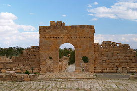 Standing in the forum, back to the temples facing the Antonine Gate. The gate was built in 139 AD and dedicated to Emperor An...