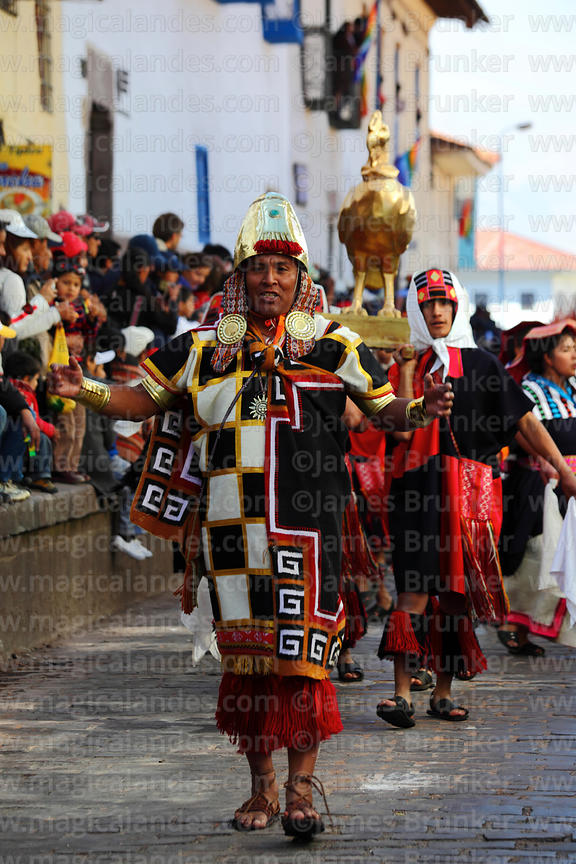 Inca general parades ahead of a golden condor during street processions for Inti Raymi festival, Cusco, Peru