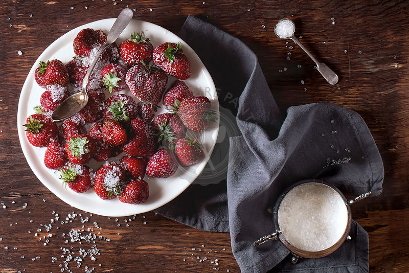 Garden strawberries with sugar and cream