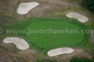 Close up aerial view of golf course and green