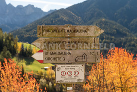 SAINT MAGDALENA, ITALY - OCTOBER 25, 2018: a rustic signpost in the dramatic countyside and mountains near Saint Magdalena in...