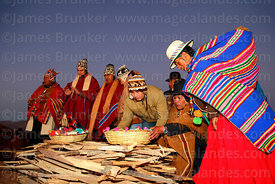 Aymara leaders putting offerings on firewood at start of Aymara New Year celebrations, Tiwanaku, Bolivia