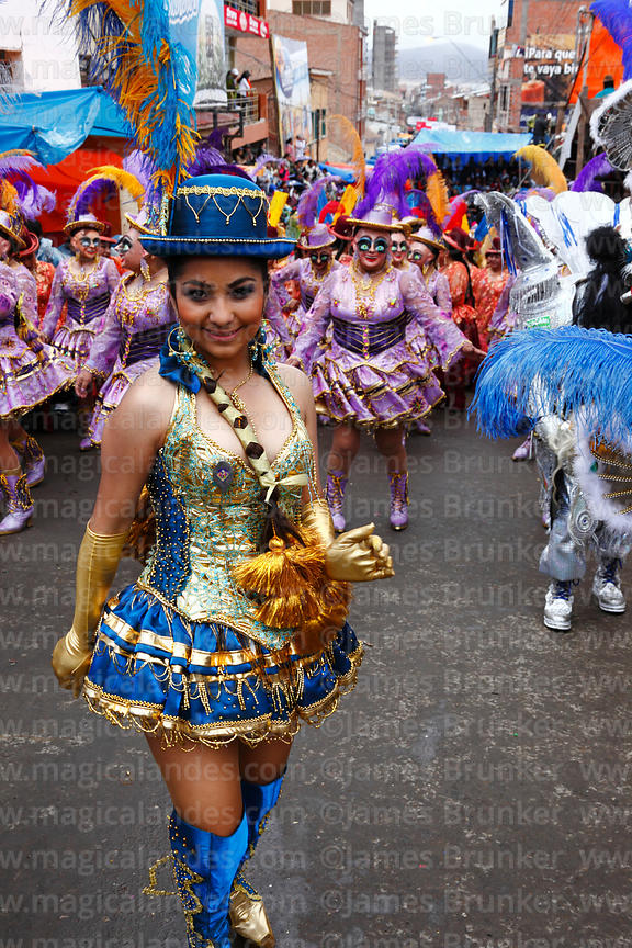 Beautiful Chinita dancer leading China Morena dancers during the Morenada, Oruro Carnival, Bolivia
