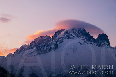 Lenticular cloud on mountain summit