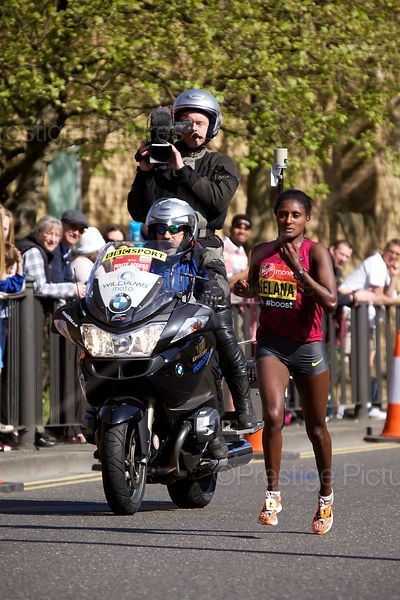 Tiki Gelana (9th) of Ethiopia Running in the  Elite Womens Event at the 2014 Virgin London Marathon with a BBC Sport Camera B...