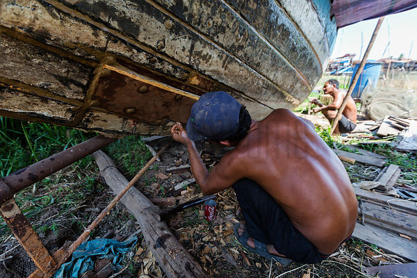 Men Repairing a Fishing Boat