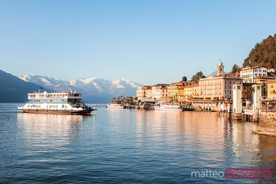 Ferry boat approaching Bellagio town, lake Como, Italy