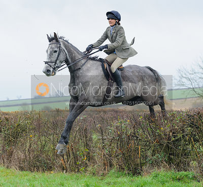 Isobel McEuen jumping a hedge behind Waterloo Lodge