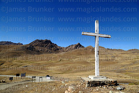Concrete cross above road and Cerro Tunari peak, Tunari National Park, Bolivia