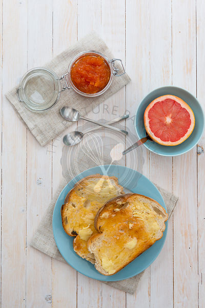 buttered toast, with a half pink grapefruit, and marmalade.