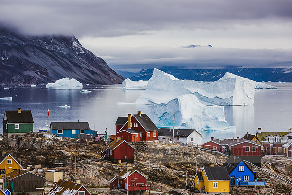 Breathtaking view on the Uummannaq houses and icebergs in the fjord as seen from the guesthouse