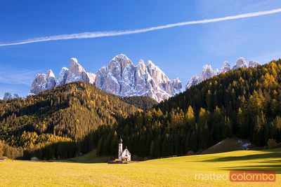 Famous St Johann church and Odle mountain range Dolomites Italy