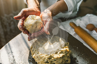 Woman Preparing Homemade Dough in the Kitchen. Preparation Raw Dough for Baking