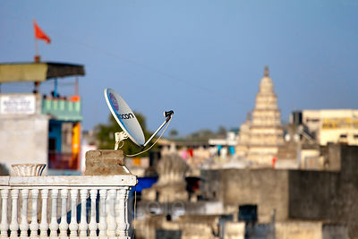 Satellite dish and Hindu temples in Pushkar, Rajasthan, India