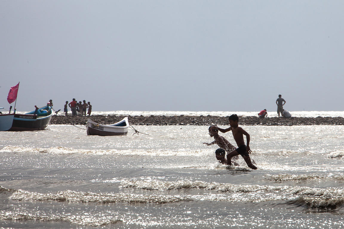Children playing in the Arabian Sea at Juhu Beach, Mumbai, India