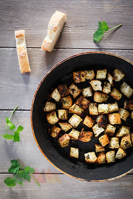 Pan of croutons with herbs