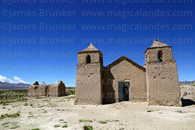 Rustic adobe church and ruined house at Pasajes, Cordillera de Sama Biological Reserve, Bolivia