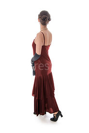 A vintage 1920s - 1930s woman in a red dress – shot from eye level.