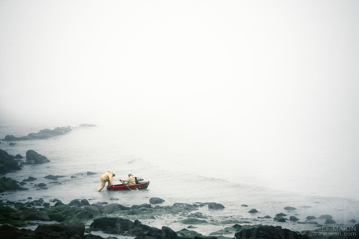 Fishermen leaving shore into the mist