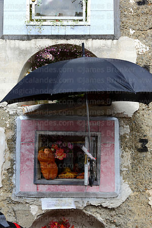 Tomb with offerings for Todos Santos festival and an umbrella to protect them from the sun, La Paz, Bolivia