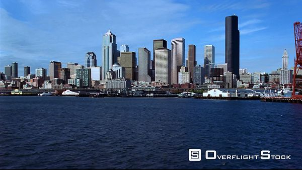 Low flight toward Seattle waterfront and skyline.