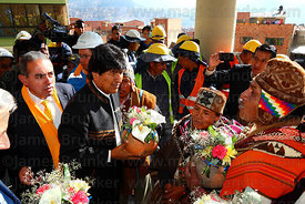 Bolivian president Evo Morales (centre) receives a ceramic pot with offerings from an Aymara amauta or shaman during the open...