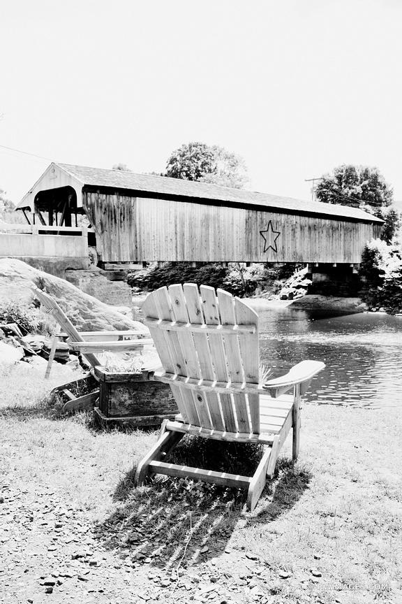 COVERED BRIDGE AND ADIRONDACK CHAIRS WAITSFIELD VERMONT BLACK AND WHITE VERTICAL