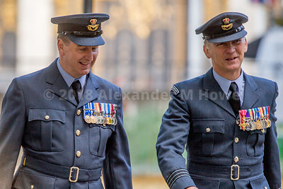 Smiling RAF officers with medals on their chests walking along The Mall