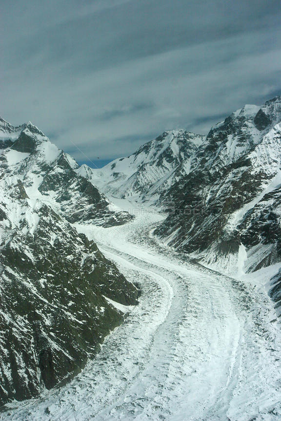 Aerial view of a glaciated valley, Concordia in the Karakoram Mountains, Himalayas, Pakistan. From Pakistani military helicop...