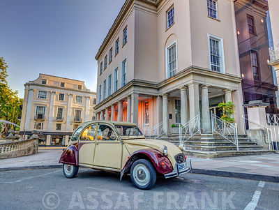 Vintage car outside a building in Cheltenham, Gloucestershire, UK
