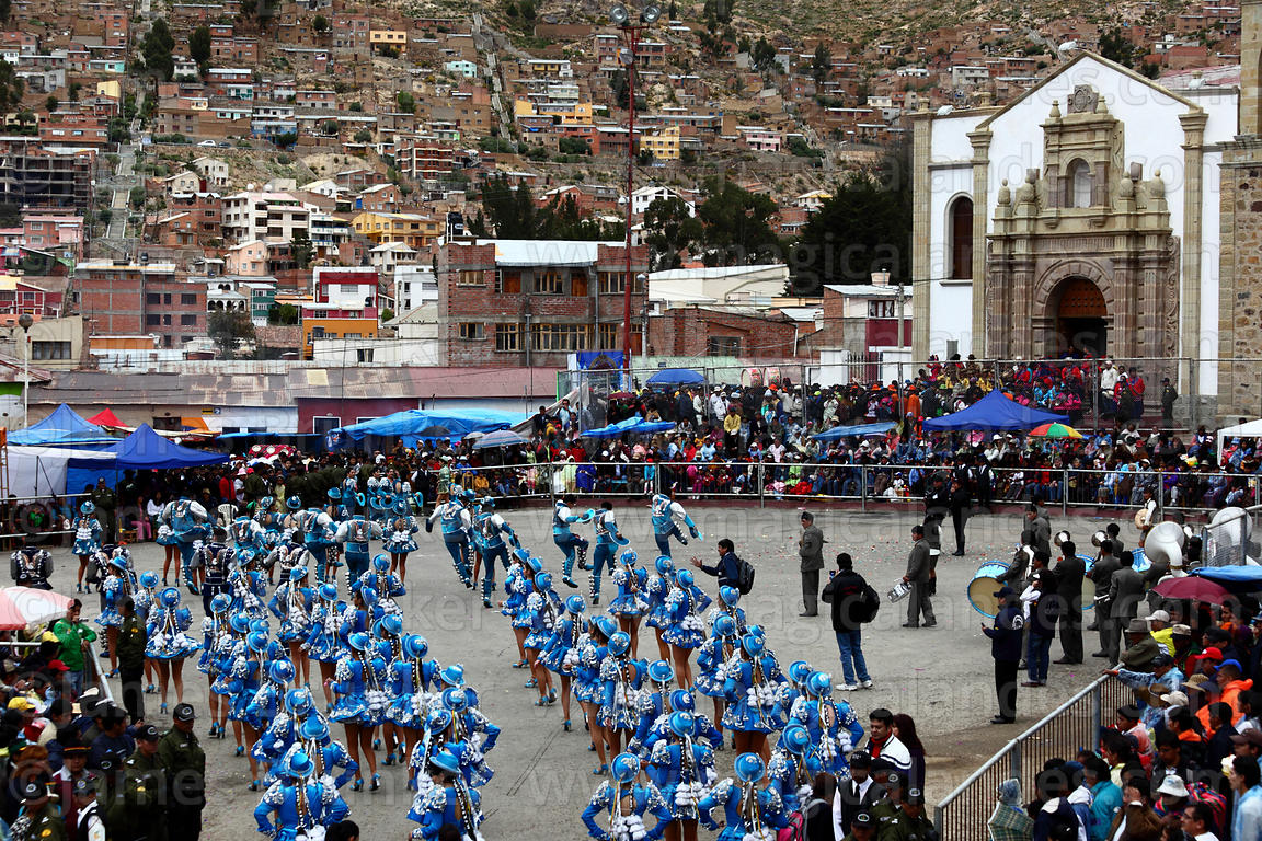 Female Caporales dancers in front of Sanctuary of Virgen del Socavon, Oruro Carnival, Bolivia