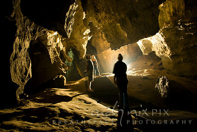Sterkfontein Caves: Three people look at the limestone stalictites and talictites in the caves.